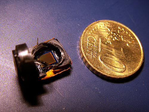 A microsensor with coin for scale  this is a titan compared to the sensors that can be injected into your body for medical monitoring (credit: beob8er, Flickr)